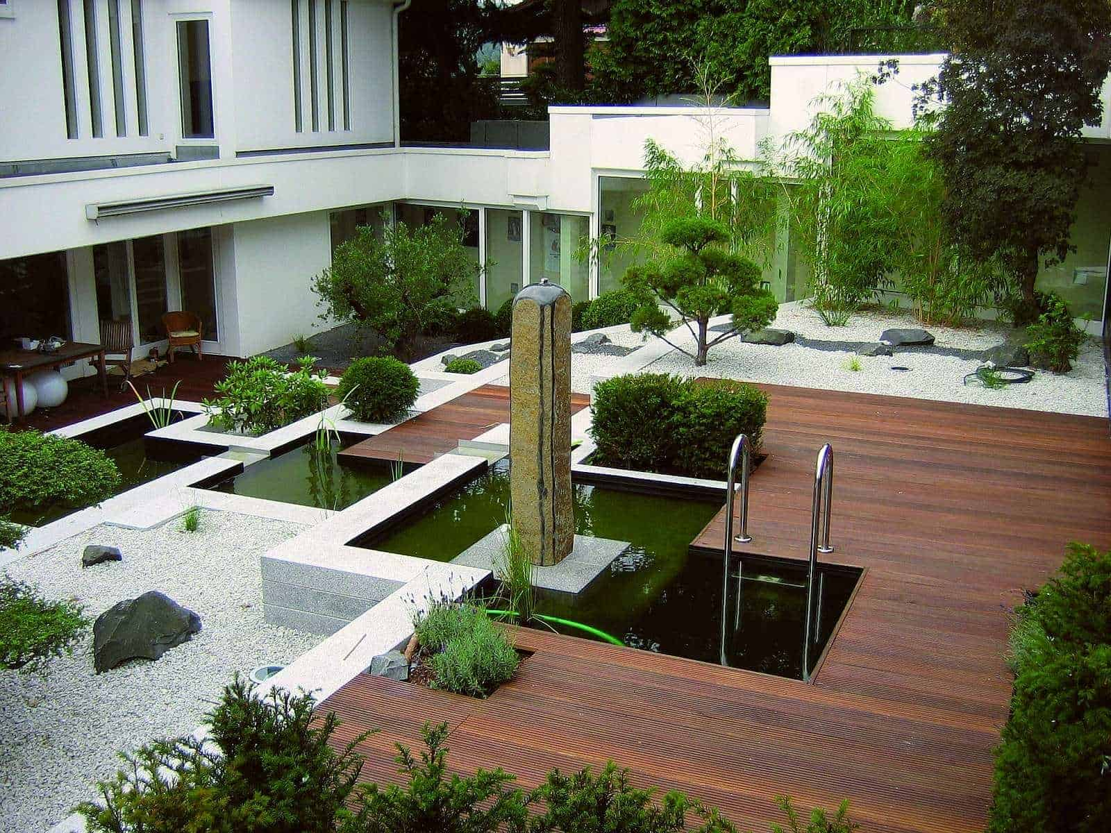 Moderne Gartengestaltung mit Granit und Holz